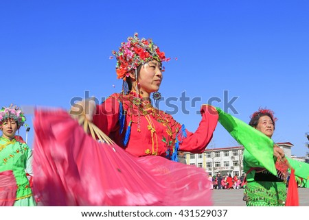 Luannan County- February 20: Chinese traditional style yangko folk dance performance in the street, on February 20, 2016, luannan County, hebei Province, China