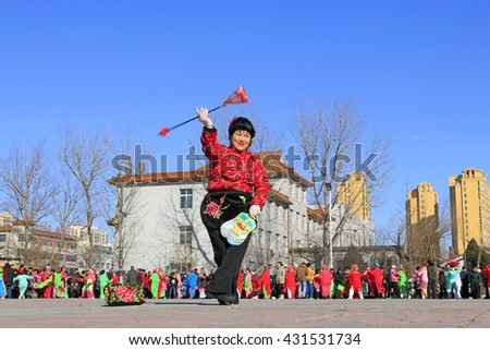 Luannan County- February 19: Chinese traditional style yangko folk dance performance in the street, on February 19, 2016, luannan County, hebei Province, China