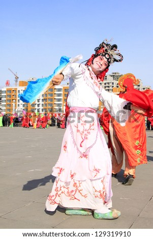 LUANNAN COUNTY - FEBRUARY 18: During the Chinese Lunar New Year, people wear colorful clothes, yangko dance performances in the streets, on February 18, 2013, Luannan County, Hebei Province, China.