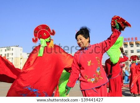 LUANNAN COUNTY  - FEBRUARY 19: During the Chinese Lunar New Year, people wear colorful clothes, yangko dance performances in the streets on February 19, 2013, Luannan County, Hebei Province, China.