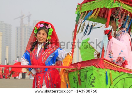 LUANNAN COUNTY - FEBRUARY 27: During the Chinese Lunar New Year, people wear colorful clothes, yangko dance performances in the streets, on February 27, 2013, Luannan County, Hebei Province, China.