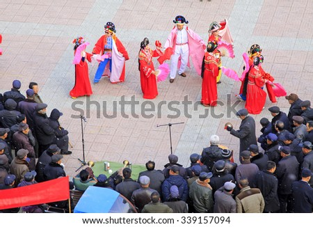 LUANNAN COUNTY - FEBRUARY 26: people watching a Chinese traditional style yangko dance in the square, on February 26, 2015, Luannan County, Hebei province, China