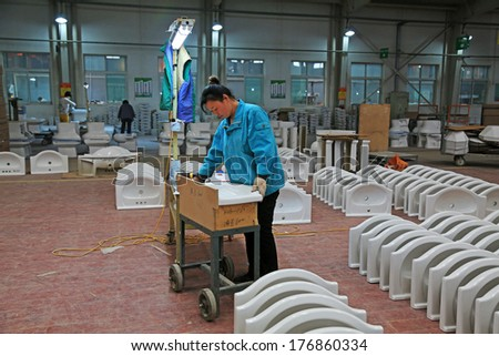 LUANNAN COUNTY - JANUARY 5: Workingwoman was testing the quality of the product, in the ZhongTong Ceramics Co., Ltd. January 5, 2014, Luannan county, Hebei Province, China.