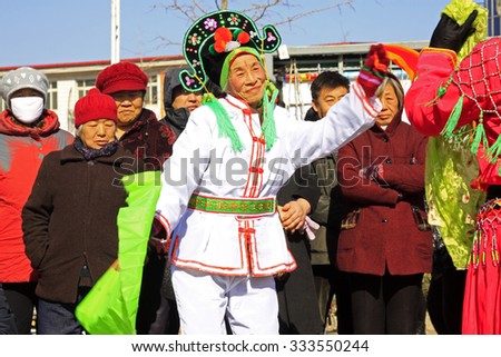 LUANNAN COUNTY - MARCH 1: traditional Chinese style yangko dance performances in the square, on march 1, 2015, Luannan County, Hebei province, China