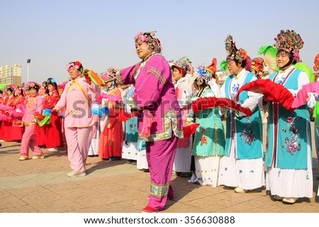LUANNAN COUNTY - MARCH 2: traditional Chinese style yangko dance performances in the square, on march 2, 2015, Luannan County, Hebei province, China