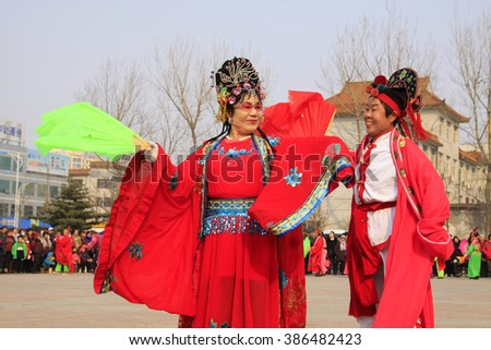 LUANNAN COUNTY - MARCH 6: traditional Chinese style yangko dance performances in the square, on march 6, 2015, Luannan County, Hebei province, China