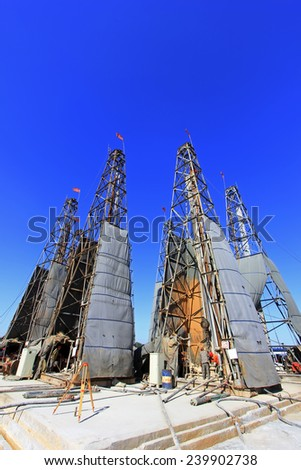 LUANNAN COUNTY - OCTOBER 13: Drilling derrick in MaCheng iron mine, on october 13, 2014, Luannan County, Hebei Province, China   - stock photo