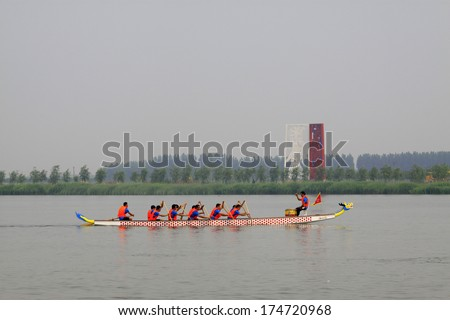 LUANNAN - JUNE 15: The dragon boat race scene in Chinese traditional Dragon Boat Festival on June 15, 2013, Luannan, Hebei Province, China.  - stock photo