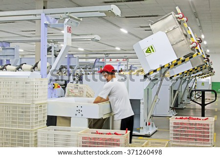 Luannan - May 31: spinning workers in the production workshop, on May 31, 2015, luannan county, hebei province, China