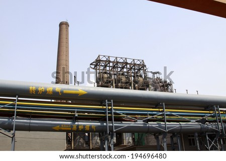"LUANNAN - MAY 4:  word ""coal gas"" written in the book of the pipeline, in a manufacturing factory, on May 4, 2014, Luannan county, hebei province, China."