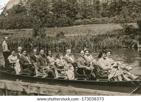 LUBBENAU, GERMANY, CIRCA FIFTIES - Vintage photo of big group of people on boat
