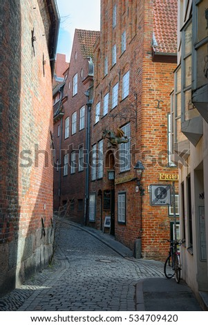LUBECK, GERMANY - APRIL 5, 2015: Streets in Lubeck old town, is the second largest city in Schleswig-Holstein, northern Germany.