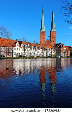 Lubeck old town with Lubeck Cathedral (Lubecker Dom) reflected in Trave river, Germany  - stock photo