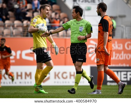 LUBIN, POLAND - APRIL 3, 2016: Referee Hiroyuki Kimura show peanalty kick during match Polish Premer League between KGHM Zaglebie Lubin - Piast Gliwice 4:1.  - stock photo