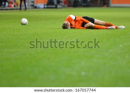 LUBIN, POLAND - DECEMBER 05: Injured Bartosz Rymaniak lying during match Polish Premier League between KGHM Zaglebie Lubin - Podbeskidzie Bielsko-Biala (3:2) on December 05, 2013 in Lubin, Poland. - stock photo