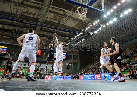 LUBIN, POLAND - DECEMBER 18, 2014: Players in action during the Euroleague basketball match between PGE Turow Zgorzelec - Emporio Armani Mediolan 96:101 - stock photo