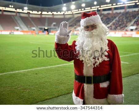 LUBIN, POLAND - DECEMBER 4, Poland: Santa Claus on the stadium during match Polish Premier League between KGHM Zaglebie Lubin - Bruk-Bet Termalica Nieciecza 2:0.  - stock photo