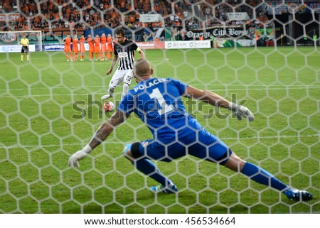 LUBIN, POLAND - JULY 21, 2016: Second Round Elimination to European League match KGHM Zaglebie Lubin - FK Partizan Belgrad 0:0 penalty 4:3. Penalty kicking  Sasa Ilic, goalkeepr Martin Polacek. - stock photo