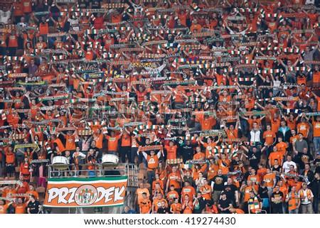 LUBIN, POLAND - MAY 11, 2016: Match Polish Premer League between KGHM Zaglebie Lubin - Lech Poznan 3:0. Supporters of Zaglebie Lubin. - stock photo