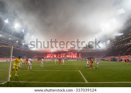 LUBIN, POLAND - NOVEMBER 6, 2015: Supporters of Zaglebie burn flares on the occasion of Independence Day during match Polish Premer League between KGHM Zaglebie Lubin - Wisla Krakow (1:3).  - stock photo