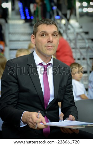 LUBIN, POLAND - NOVEMBER 06, 2014: Trainer of PGE Turow Zgorzelec - Miodrag Rajkovic before match Euroleague basketball  between PGE Turow Zgorzelec - Bayern Munich 89:78. - stock photo