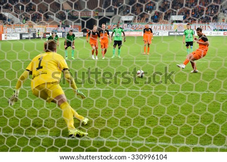 LUBIN, POLAND - OCTOBER 24, 2015: Michal Papadopulos shotting penalty kick goalkeeper Silvio Rodic during match Polish Premer League between KGHM Zaglebie Lubin - Gornik Leczna (0:0).  - stock photo