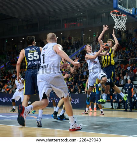 LUBIN, POLAND - OCTOBER 24, 2014: Nemanja Jaramaz (10) in action during the Euroleague basketball match between PGE Turow Zgorzelec - Fenerbache Ulker Stambul 76:91. - stock photo