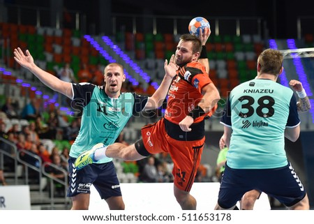 LUBIN, POLAND - OCTOBER 19, 2016: Polish PGNiG Superleague men in handball match between MKS Zaglebie Lubin - Sandra SPA Pogon Szczecin 26:27. In action Mikolaj Szymyslik (11).