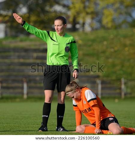 LUBIN, POLAND - OCTOBER 25, 2014: Referee Michalina Diakow during match Polish women's EkstraLeague between KGHM Zaglebie Lubin - FC Katowice 4:0. - stock photo