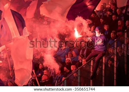 LUBIN, POLAND - OCTOBER 28, 2015: supporters of Lech Poznan burn flares during match Polish Cup between KGHM Zaglebie Lubin - Lech Poznan 0:1 - stock photo