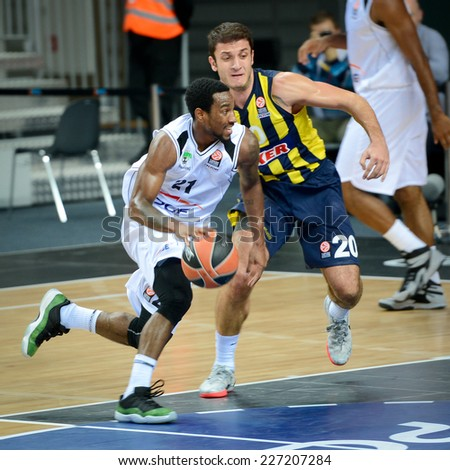 LUBIN, POLAND - OCTOBER 24, 2014: Tony Taylor (21) and Can Altintig (20) in action during the Euroleague basketball match between PGE Turow Zgorzelec - Fenerbache Ulker Stambul 76:91. - stock photo