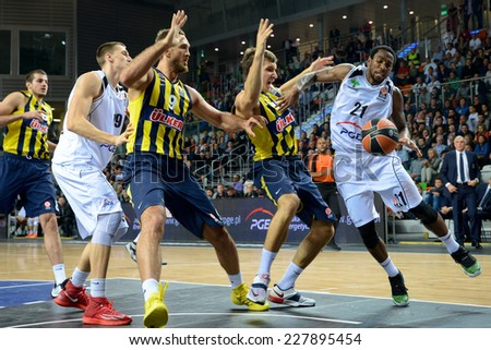 LUBIN, POLAND - OCTOBER 24, 2014: Uros Nikolic (19), Semih Erden (9), Bogdan Bogdanovic (13) i Tony Taylor (21) during the Euroleague match between PGE Turow Zgorzelec - Fenerbache Ulker Stambul. - stock photo