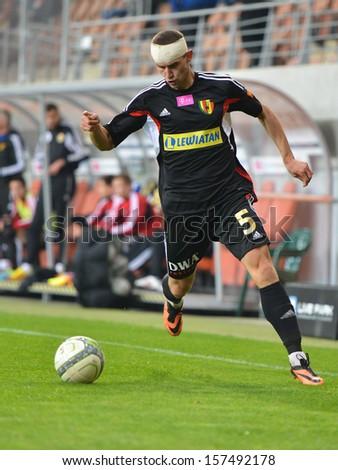 LUBIN, POLAND - SEPTEMBER 21: Serhii Pylypchuk in action during match Polish Premier League KGHM Zaglebie Lubin - Korona Kielce (2:0) on September 21, 2013 in Lubin, Poland. - stock photo