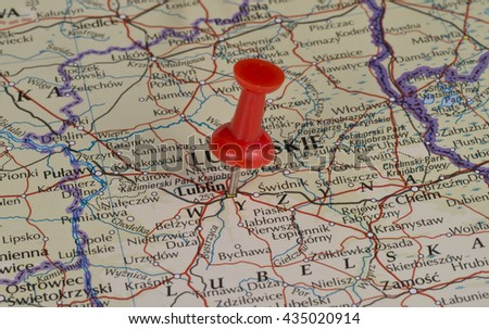 Lublin Poland marked on map with red pushpin. Selective focus on the word Lublin and the pushpin. Pin is in an angle.  - stock photo