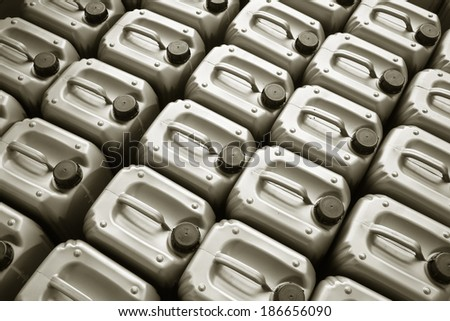 Lubricating oil in typical containers - stock photo