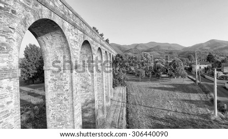 Lucca. Aerial view of ancient aqueduct. - stock photo
