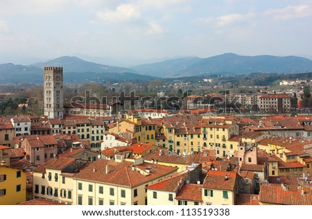 Lucca in Tuscany, Italy an Aerial panoramic view with Piazza dell' Anfiteatro in a bright sunny day. - stock photo