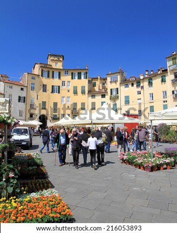 LUCCA, ITALY - APRIL 24, 2014:  Tourists in Piazza Santa Maria in Lucca, Italy.