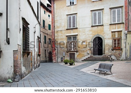 LUCCA, ITALY - JANUARY 16, 2015: Via Burlamacchi street and Piazza Del Palazzo Dipinto square in old town of Lucca, Italy. Medieval small city in Tusqany.