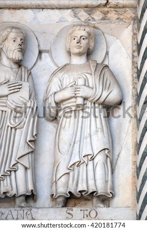 LUCCA, ITALY - JUNE 06, 2015: Bas-relief representing the Saint Thomas the Apostle, Cathedral of S.Martino in Lucca, Italy, on June 06, 2015