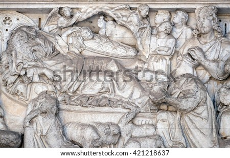 LUCCA, ITALY - JUNE 06, 2015: Nativity, Birth of Jesus, lunette over the portal of Cathedral of St Martin in Lucca, Italy, on June 06, 2015
