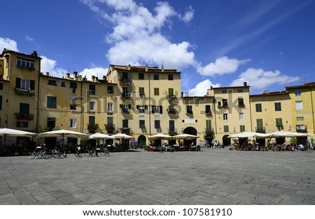 LUCCA, ITALY - JUNE 11: the square of Piazza dell'Anfiteatro was built on the ruins of the ancient Roman amphitheatre and is one of the landmarks in the medieval city on June 11, 2012 in Lucca, Italy