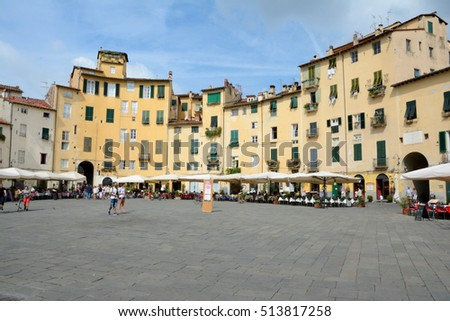 Lucca, Italy - September 5, 2016: Buildings on Piazza Napoleone square in old part of Lucca city in Italy. Unidentified people visible.