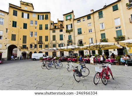 LUCCA, ITALY  SEPTEMBER 3, 2014: Famous circular Piazza dell'Anfiteatro, the ancient site of a Roman Amphitheatre,  in Lucca, Tuscany, Italy.  - stock photo