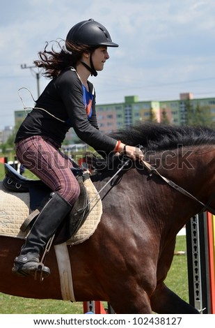 LUCENEC, SLOVAKIA MAY 13: Unidentified rider competes at the Horse Day Show 2012 on May 13, 2012 in Lucenec, Slovakia