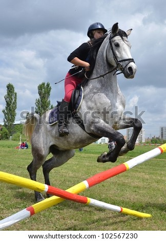 LUCENEC, SLOVAKIA MAY 13, Unidentified rider participates on the Horse Day Show jumping May 13, 2012 in Lucenec, Slovakia - stock photo
