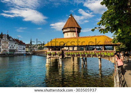 LUCERNE, SWITZERLAND - AUGUST 2: Views of the famous bridge Kapellbruecke on late afternoon in Lucerne on August 2, 2015. Lucerne is a famous tourist destination in Switzerland.