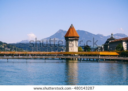 LUCERNE, SWITZERLAND - CIRCA AUGUST 2011: The famous Chapel Bridge across the Reuss River, the oldest wooden covered bridge in Europe and a symbol of the city of Lucerne