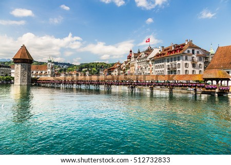 Lucerne, Switzerland - June 23, 2012: Famous wooden Chapel Bridge in Lucerne, Switzerland