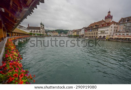 LUCERNE, SWITZERLAND - JUNE 28: Lake Lucerne and the shore in Lucerne, Switzerland on June 28, 2013. It is a famous tourist destination in Switzerland with the view of Swiss Alps.